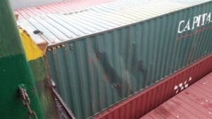 damaged shipping container after shock